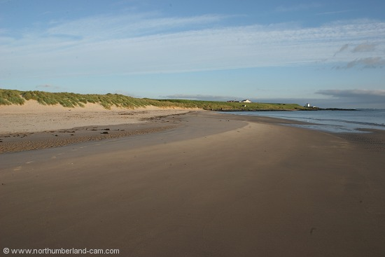 Early summer morning view of Bamburgh Beach.