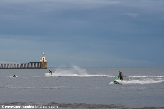 Jet Skiers on a calm day in winter.