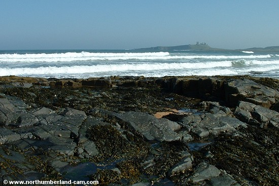View across the bay to Dunstanburgh Castle.