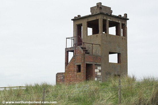 Derelict lookout tower in the dunes.