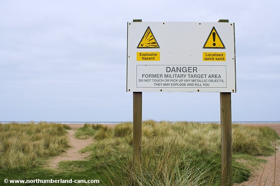 Warning sign at Goswick Sands.